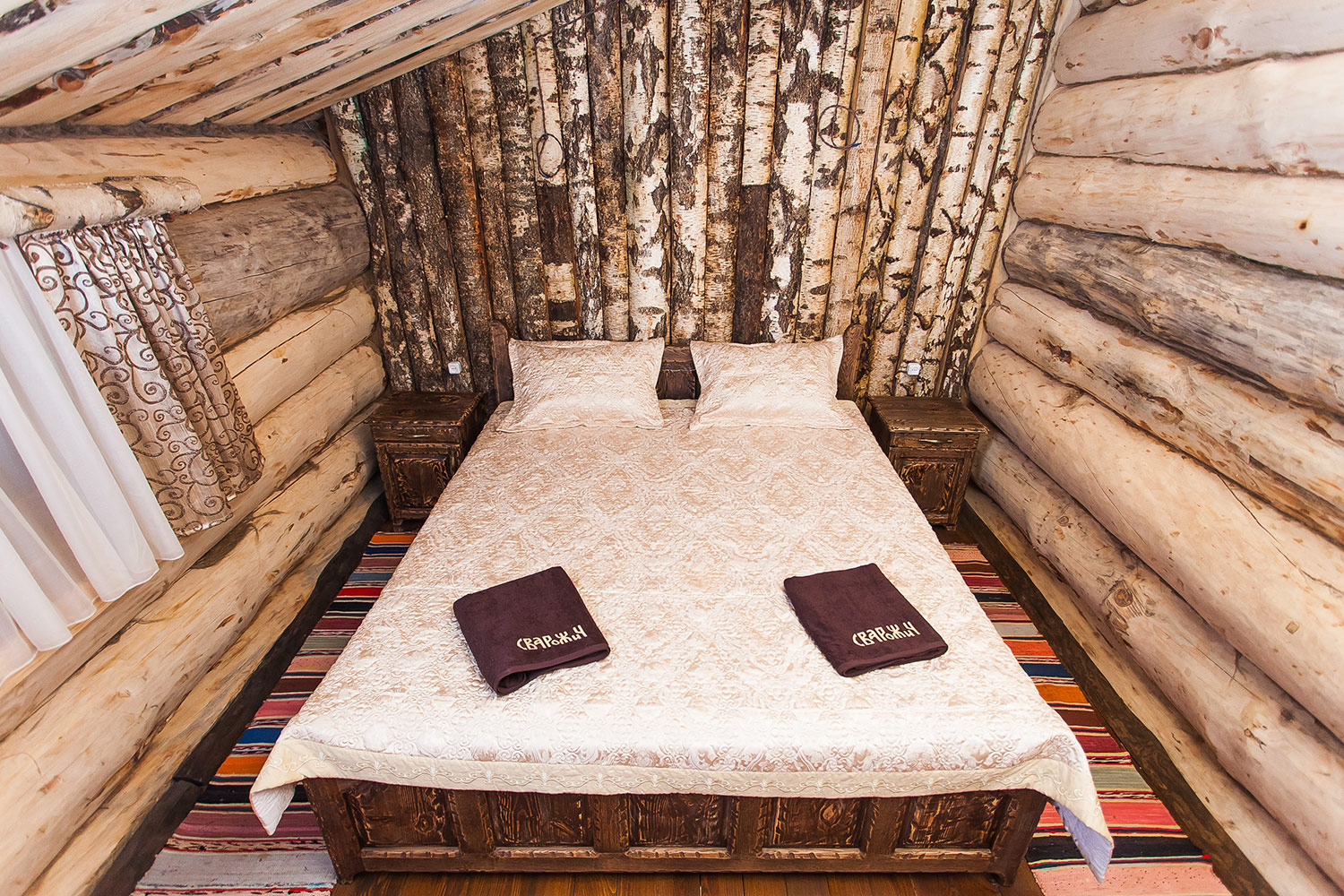 The Svarozhych bathhouse. A natural wooden bedroom. A blockhouse. The logo embroidery on towels.