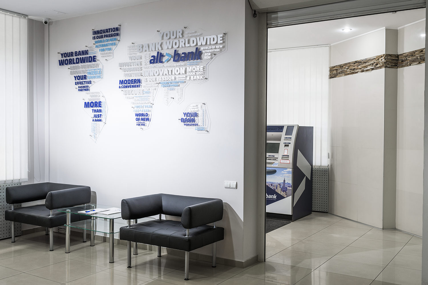 The bank branch interior design. The Altbank ATM. A transparent world map on the wall. Design of the Altbank ATM.