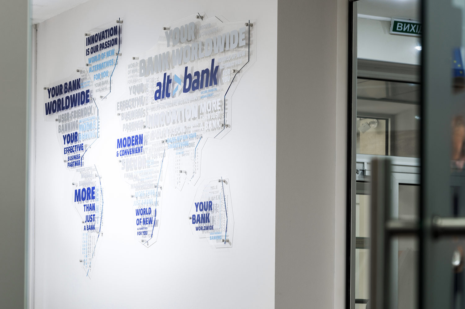 World map with the logo. An acrylic wall map. Transparent acryl. The Altbank bank.