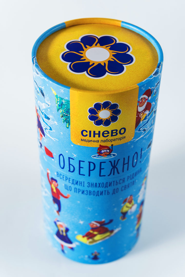 A festive New Year wrapping. A gift cardboard tube packaging for alcohol. A New Year's package SYNEVO design.