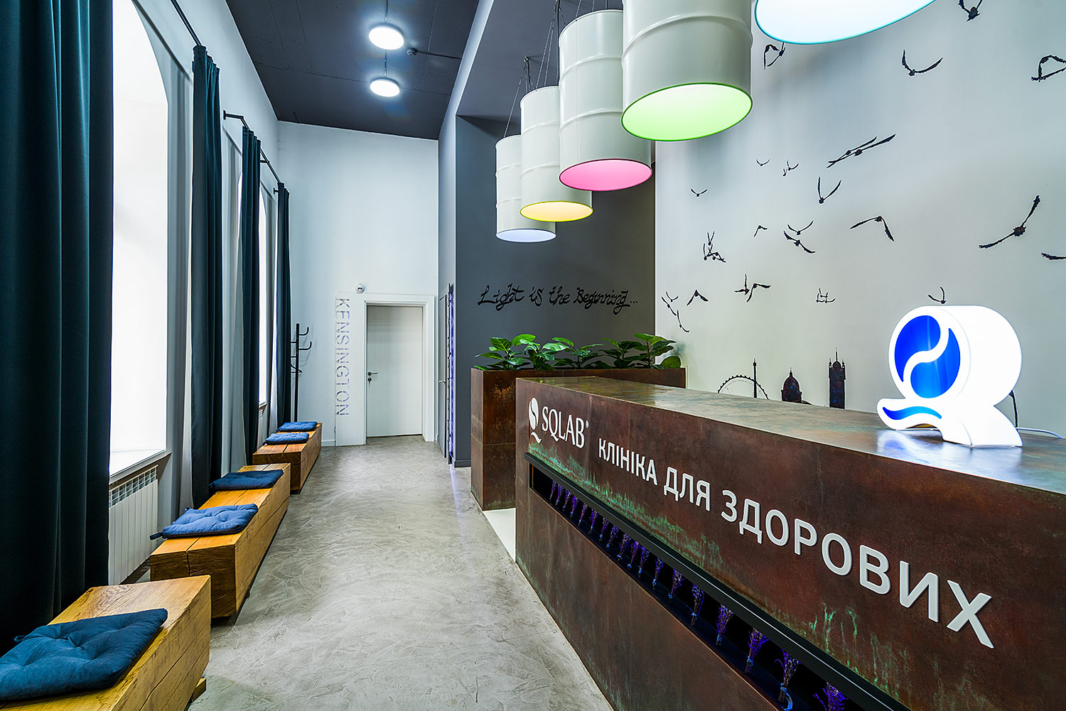SQLAB clinic reception desk branding, and manufacture of the designer tabletop lamp in the shape of a logo.