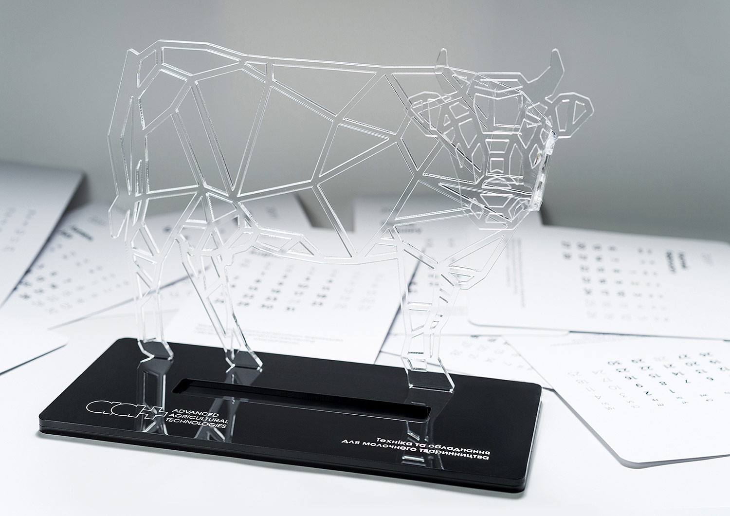 Acrylic cow — stand for desktop calendar. Black acrylic and clear acrylic, a stylish combination in a universal calendar with replaceable sheets. Universal business souvenir.
