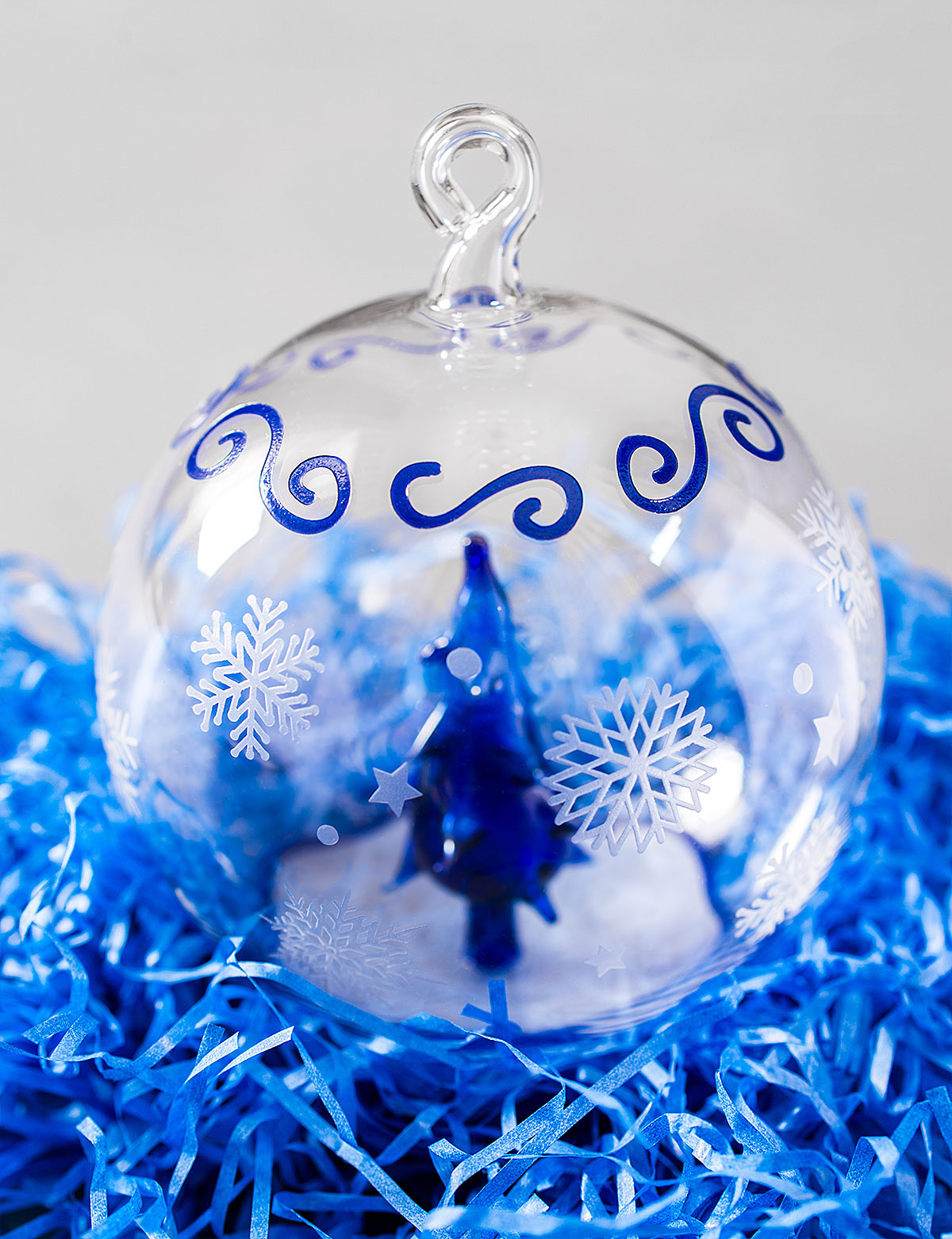Handmade designer Christmas tree toy. Laser engraving on glass and painting on glass. New Year decorations as a gift for Altbank bank customers.