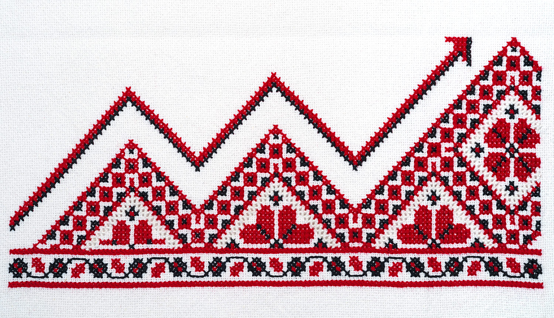 Традиционная украинская вышивка для дизайна обложки книги. Финансовый график вышит красными и черными нитками на рушнике.