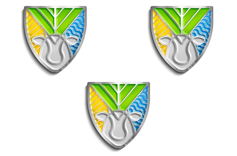 Металеві значки у вигляді логотипа СФГ «Віталія». Хімічне травлення металу, кольорові емалі.