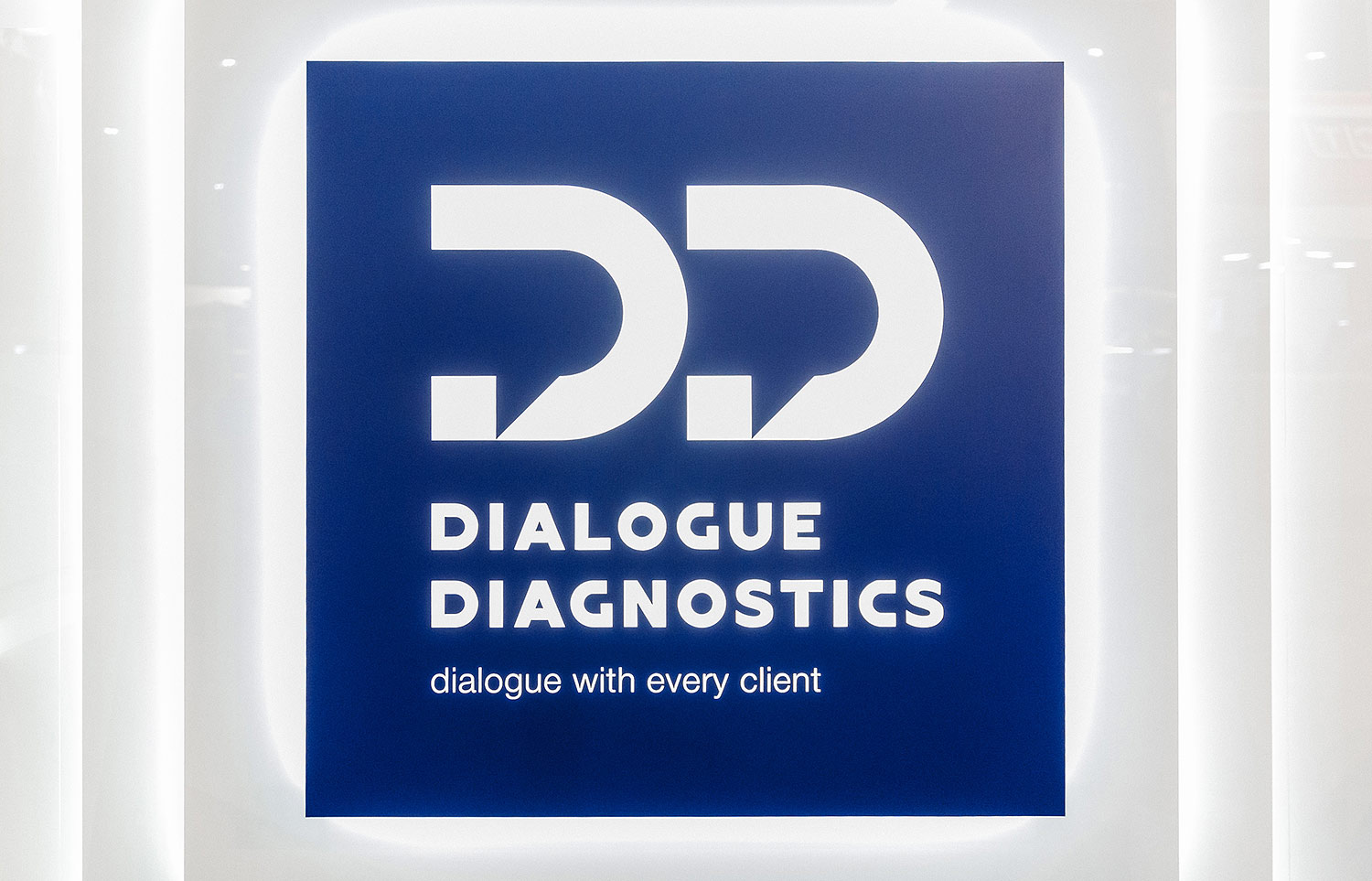 The backlit logo on the Dialogue Diagnostics exhibition stand.