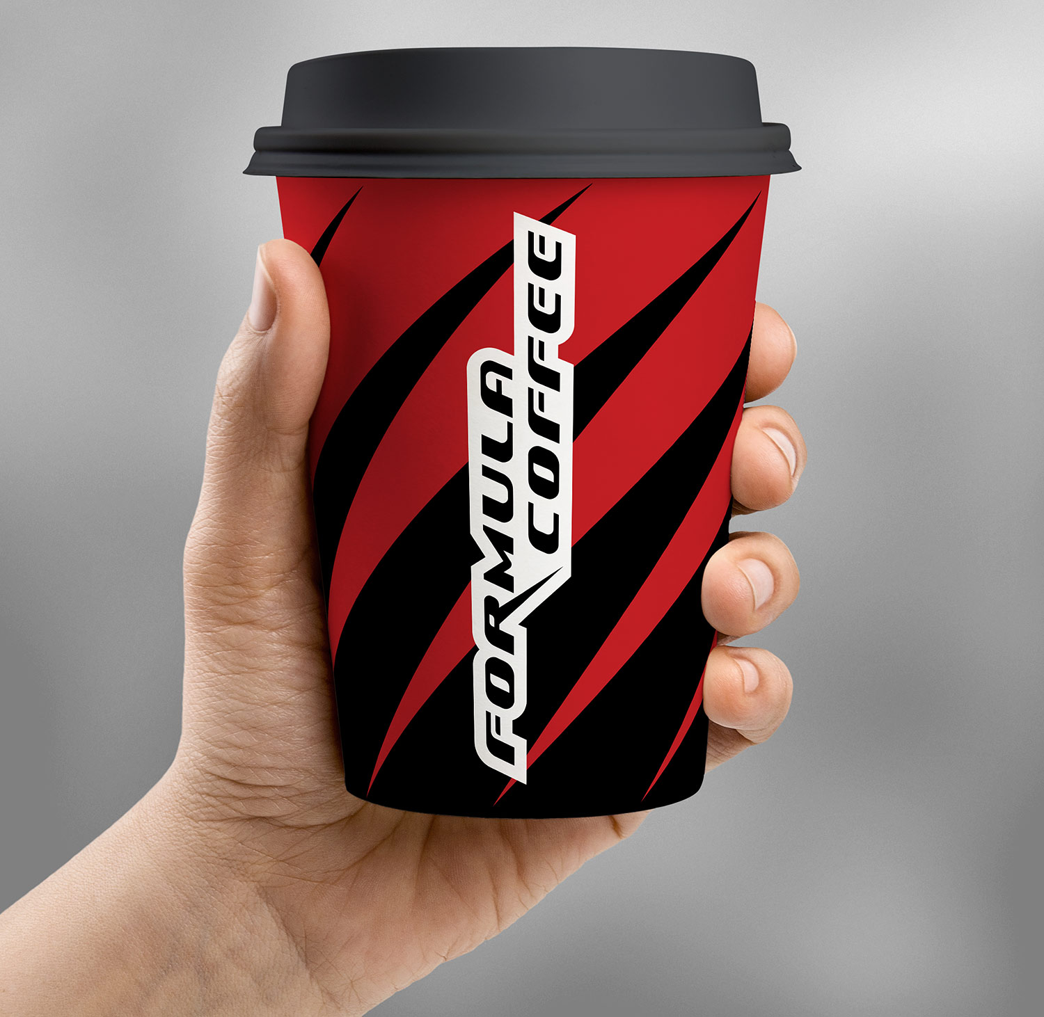A branded cardboard coffee cup with the logo Formula Coffee.
