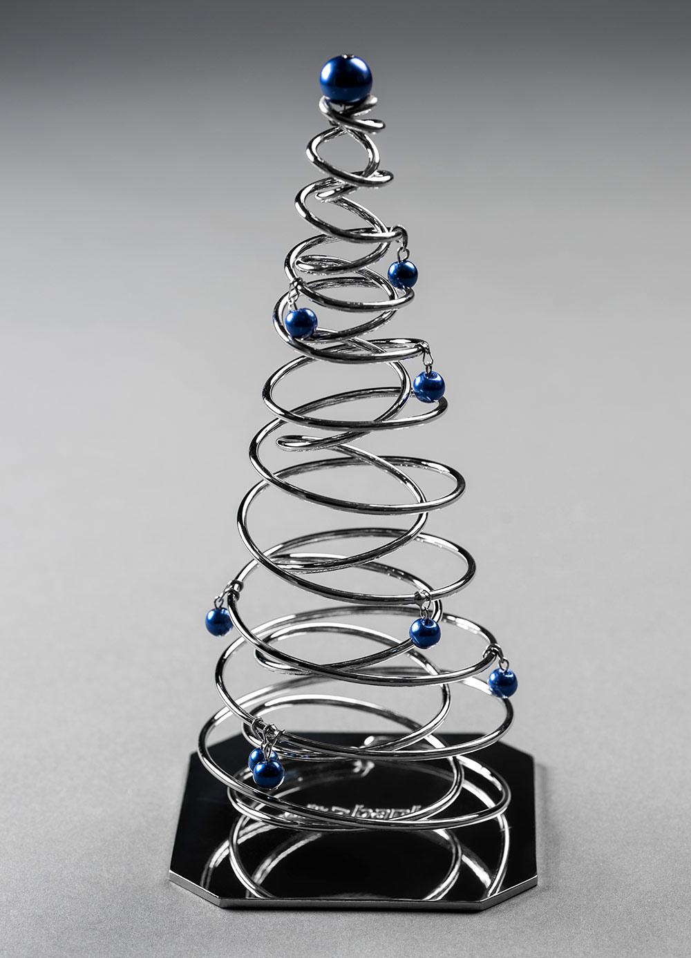 Handmade metal Christmas tree and corporate color Christmas balls. Chrome and dark blue.