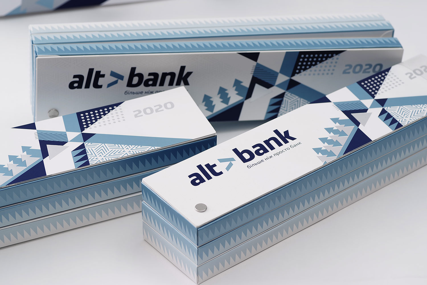 Unusual beautiful box for chocolate. Blue silver Pantone 8201, silver foil, holniten, fan shape packaging, geometric design with geometric illustration, Swedish design for Altbank bank.